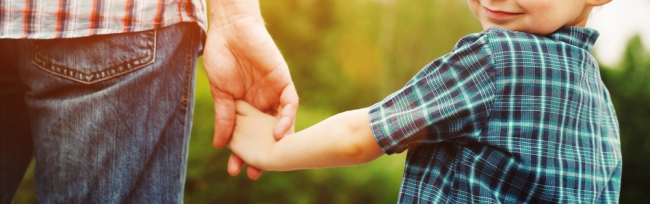 child holding parent's hand