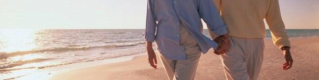 A couple walking along the beach