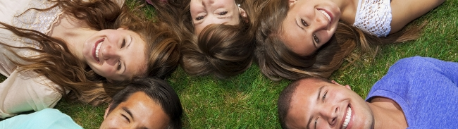 Young people lying on the grass