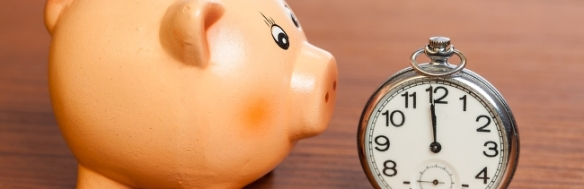 Piggie bank and a stopwatch