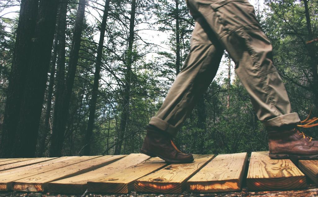 man walking on plank