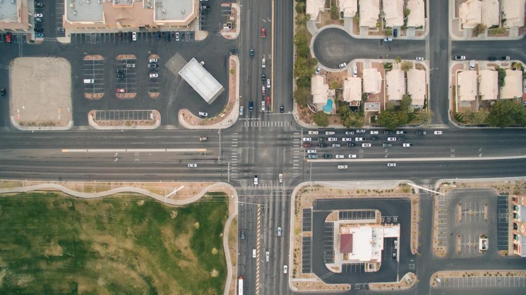 bird-s-eye-view-cars-crossing-crossroad