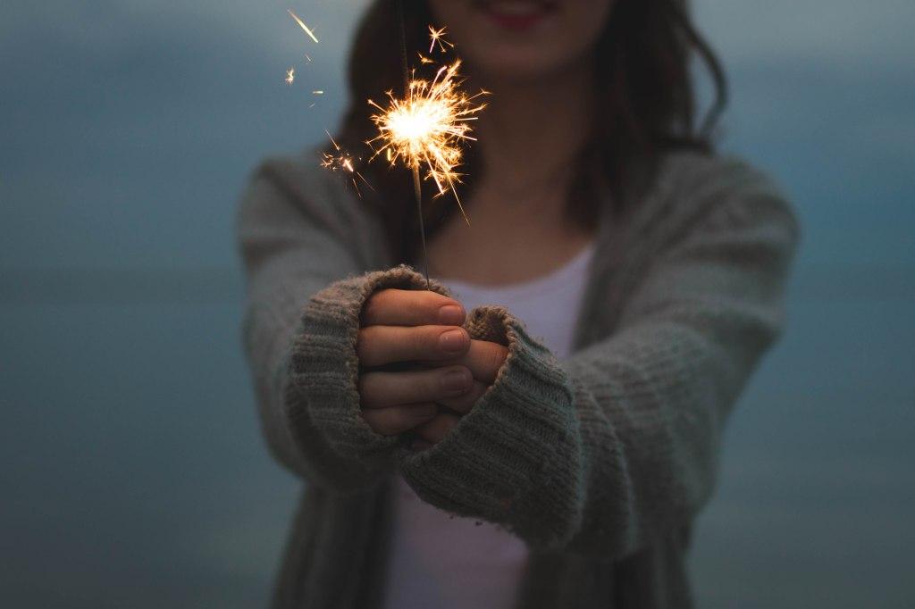 girl holding sparkle